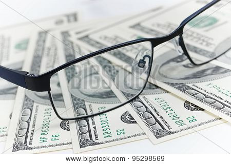 Black Glasses And Dollars