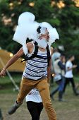 BONTIDA - JUNE 28, 2015: Festival participants playing with helium bubbles at the Electric Castle Festival at June 28, 2015 in the Banffy castle in Bontida, Romania poster