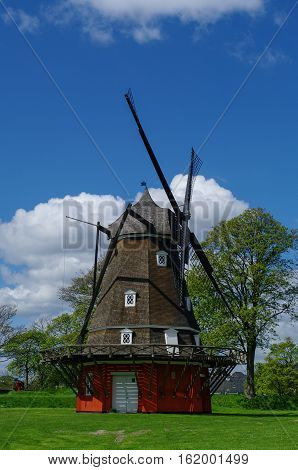 Red Wooden Windmill In Kastellet Fortress (the Old Military Fortress), Copenhagen, Denmark