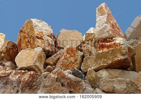 a pile of big rocks against sky