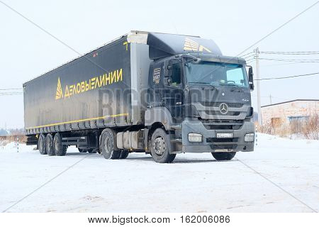 Moscow, Russia - December, 9, 2016: truck with semi-trailer on a parking in Moscow, Russia