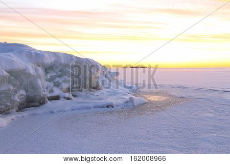 Beautiful snow landscape with colorful dawning sky