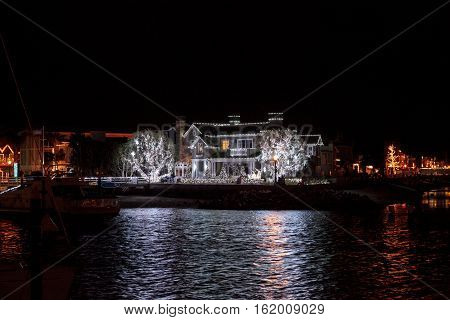 December 16, 2016 - Newport Beach, CA, USA: Colorful holiday lights on a home along the harbor at Balboa Island. Editorial use only.
