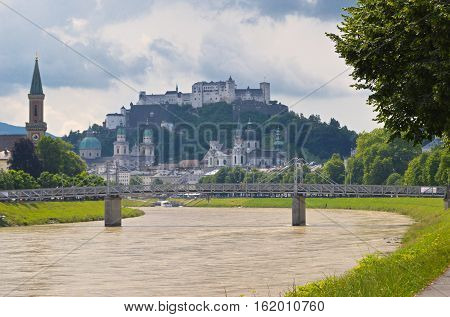 The old town of Salzburg, Austria is nestled protectively under Hohensalzburg Fortress