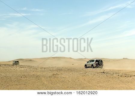Jeeps traditional Safari Dune Bashing with tourists Oman Ubar in Desert Rub al Khali