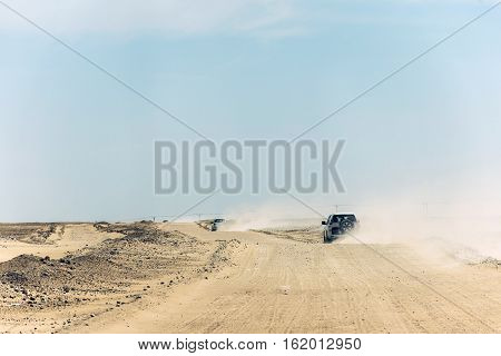 Jeeps traditional Safari Dune Bashing with tourists Oman Ubar in Desert Rub al Khali 2