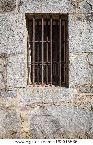 Old Stone Jail House Window with bars