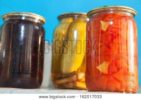 jars of homemade preservatives vegetables and fruits
