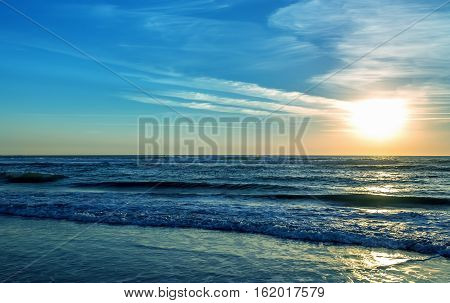 Beautiful sunrise over the sea or ocean with clouds