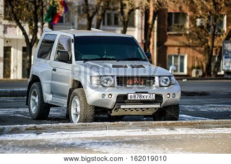 KHABAROVSK RUSSIA - NOVEMBER 4: jeep Mitsubishi Pajero Evolution in silver color is on the street. November 4, 2016 in Khabarovsk, Russia