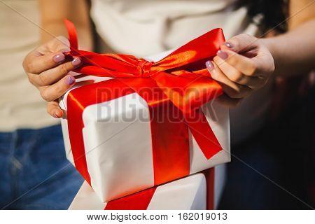 Woman Unpacking Christmas Box