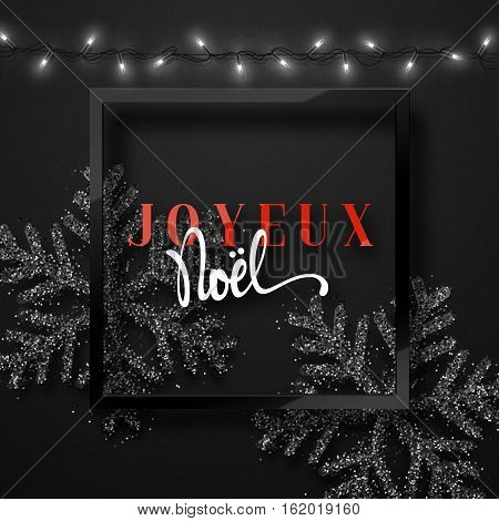 Merry Christmas. French inscription. Joyeux Noel. Christmas background black, beautiful bright snowflakes realistic shine glitter. Framed calligraphy handmade. Xmas holidays poster, greeting card.