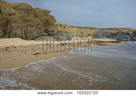 coast in the summer with sand and waves