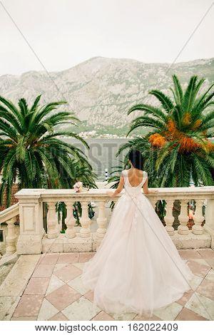 Bride In Wedding Dress With Church Background