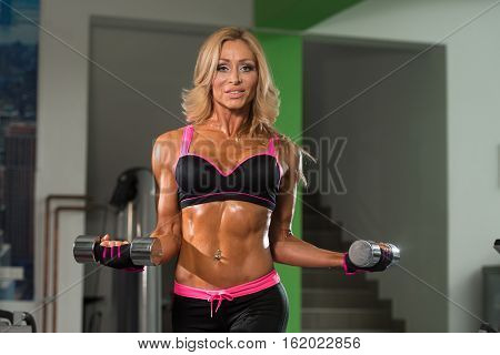 Healthy Mature Woman Doing Exercise For Biceps