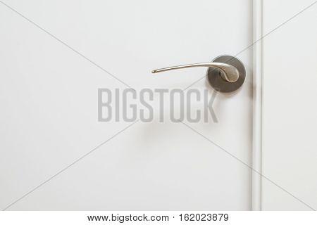 Metal Door Handle Isolated On White Door