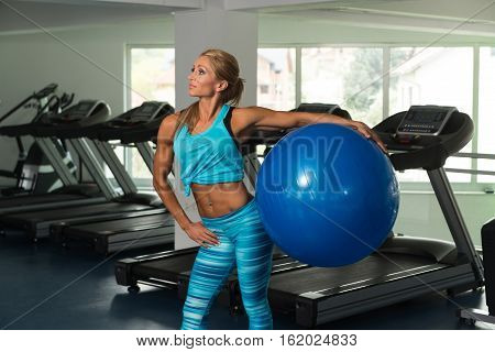 Healthy Mature Woman Doing Exercise On Ball