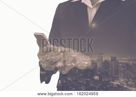 double exposure of businessman and cityscape with vintage filter - can use to display or montage on product