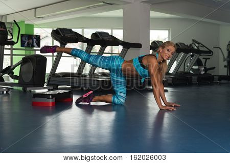 Healthy Woman Doing Push Ups On Stepper