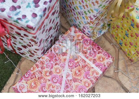 Winter Rain Drop On Colorful Gift Box Present, Christmas And New Year Festival
