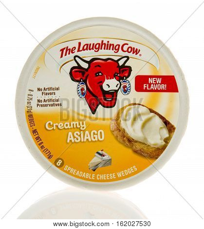 Winneconne WI - 13 December 2016: Container of The Laughing Cow in creamy asiago flavor on an isolated background.