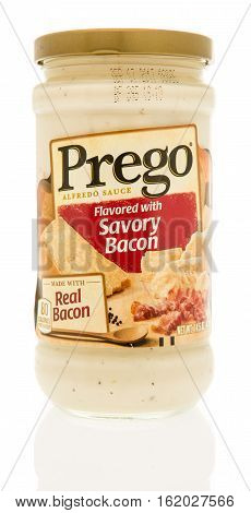 Winneconne WI - 13 December 2016: Jar of Prego Savory bacon alfredo sauce on an isolated background.