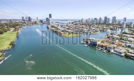 Aerial view facing north on Gold Coast waterways with Macintosh Island on the right.