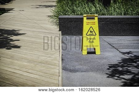 Wet floor sign in the garden, oudoor.
