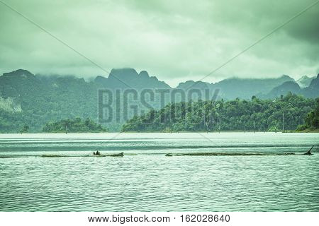 Mountain view with sky cloud fog and water surface at chiewlarn dam or ratchaprapa dam Suratthani Thailand.