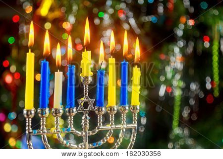 Happy Hanukkah. Low Key Image Of Jewish Holiday With Menorah The Night View Out Focus