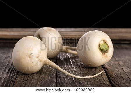 Turnip on wooden table. A healthy vegetable