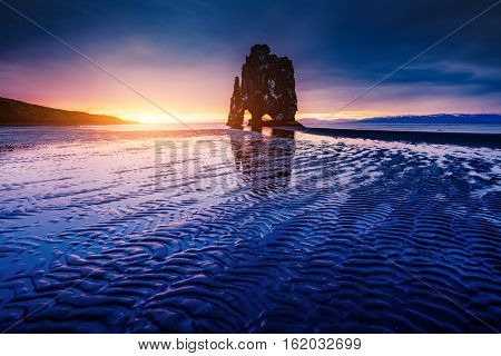 Spectacular dark sand after the tide. Picturesque and gorgeous scene. Location famous place Hvitserkur rock, Vatnsnes peninsula, northwest Iceland, Europe. Popular tourist attraction. Beauty world.