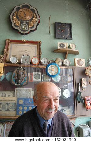 picture of a Old clockmaker posing in his workshop Jan22.2011 Resen Macedonia