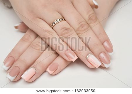 Manicure Beauty treatment photo of nice manicured woman fingernails. Very nice feminine nail art with nice pink, gold and black nail polish. poster