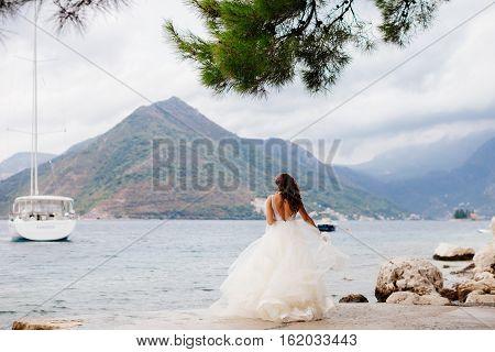 Unidentified Bride Walking In Picturesque Bay