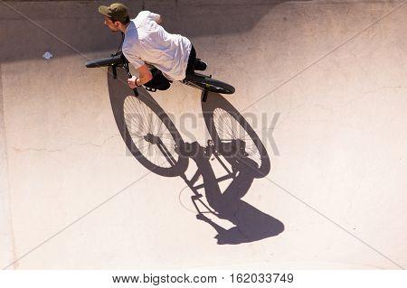 BARCELONA SPAIN - MAY 31 2016: MAN HAS FUN WITH HIS BMX AT THE SKATEPARK NEXT TO LA BARCELONETA BEACH STREET WALKING AREA