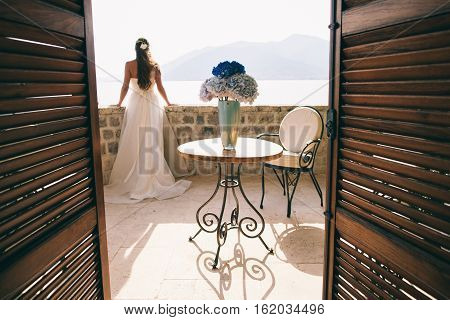 Wedding Bride With Bouquet In Hotel With Sea View