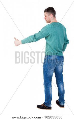 Back view of  man thumbs up. Rear view people collection. backside view of person. Isolated over white background.  The guy in the green jacket stands sideways and shows thumb down right