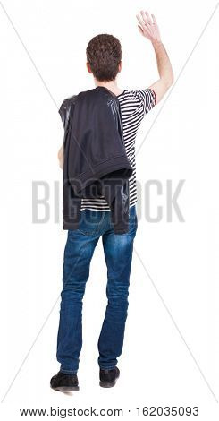Back view of beautiful man welcomes. man hand waving from. Rear view  people collection.   Isolated over white background. Putting the jacket on the guy waving his right shoulder with his other hand.
