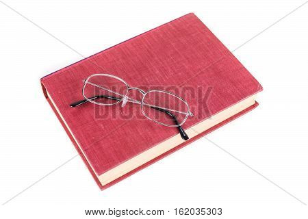Book With Reading Glasses Isolated On White Background