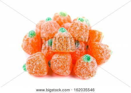 Pile Of Sour Pumpkin Chewy Candies Isolated On White Background