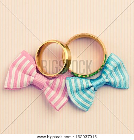 Wedding card background - two gold wedding rings and two bows , Vintage style