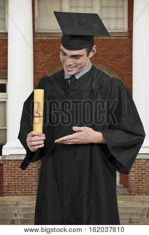 Handsome young man in his graduation robes