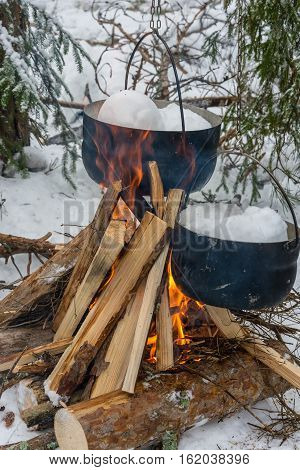 On The Fire In The Cauldrons Melted Snow.