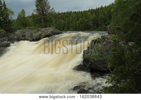 Russia,Karelia, the threshold on the river in the forest.