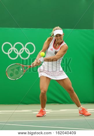 RIO DE JANEIRO, BRAZIL - AUGUST 7, 2016: Grand Slam champion Angelique Kerber of Germany in action during tennis singles first round match of the Rio 2016 Olympic Games at the Olympic Tennis Centre