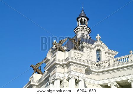 KAZAN RUSSIA - April 18.2010: Chimeras on the roof of right portal of Palace of Farmers