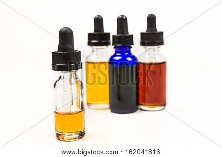 Flavored Vape Juice With Shallow Depth Of Field And Objects Out Of Focus Isolated On White Backgroun