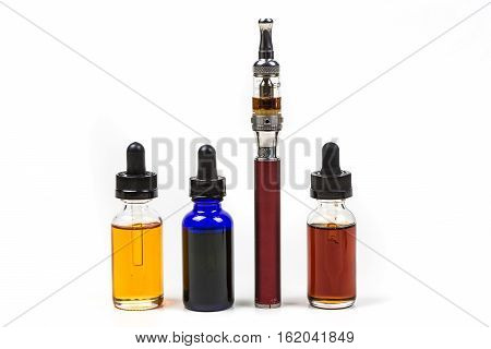 Flavored Vape Juice And Ecigarette With Shallow Depth Of Field And Objects Out Of Focus Isolated On