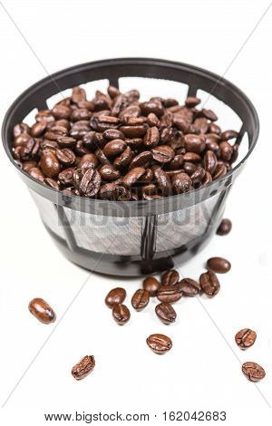Reusable Coffee Filter Filled With Beans Isolated On White Background
